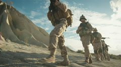 Squad of Fully Equipped and Armed Soldiers Standing in the Desert. Stock Footage