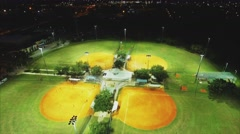 Aerial shot of baseball fields at night. Stock Footage