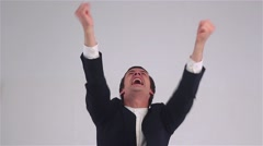 Businessman shouting at the sky waving hands Stock Footage
