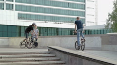 Tracers with BMX bikes ride in the city. Stock Footage