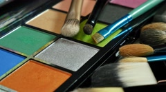 A 4K footage showing a make up palette and some brushes lying in front of it Stock Footage
