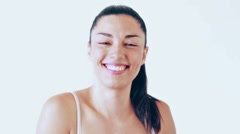 Close up portrait of woman without makeup winking and sending kiss to camera Stock Footage