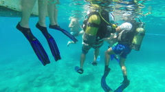 Divers prepare to dive into the water, slow motion 2 Stock Footage