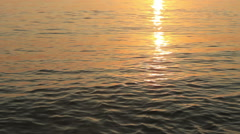 Beautiful colors of sunset, reflecting sun light over the sea. Stock Footage
