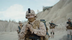 Soldier Throwing a Granade during Combat in the Desert. Slow Motion. Stock Footage