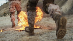 Close-up Shot of Soldiers Walking on Burning Ground in the Desert. Slow Motion. Stock Footage