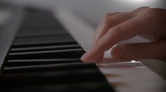 Female hand playing electric keyboard Stock Footage