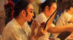 Chinese opera performers applies make-up Stock Footage