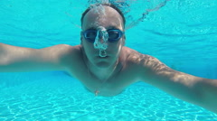 Adult man underwater in a swimming pool, slow motion 1 Stock Footage