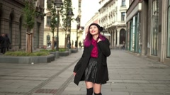 Young girl in Autumn Fashion walking the city Stock Footage