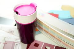 Purple cup with palette in the office of  modern designer Kuvituskuvat