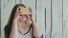 Young woman with long hair using Virtual Reality Glasses Stock Footage