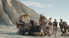 Soldiers are Using Drone for Scouting During Military Operation in the Desert.  Stock Footage