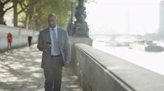 4K London businessman texting on phone as he walks through city Stock Footage