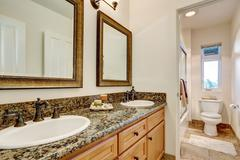 Double sink bathroom vanity with antique faucets and decorative candles on th Stock Photos