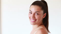 Close up of smiling woman without makeup looking at camera Stock Footage