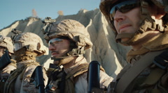 Close-up Shot Group of Fully Equipped Soldiers Standing in a Line in the Desert. Stock Footage