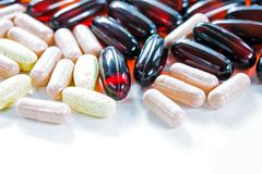 Vitamins, omega 3, cod-liver oil, dietary supplement and tablets an embankmen Stock Photos