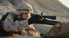 Close-up of Sniper Lies Down on the Hill and Aims through the Rifle Scope  Stock Footage