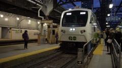 GO Train arriving at Union train station - Toronto, Ontario, Canada Stock Footage