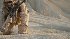 Close-up of Sniper Lies Down on the Hill, Aims through the Rifle Scope  Stock Footage