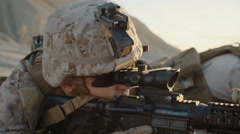Close-up of Soldier Lies Down on the Hill, Aims through the Assault Rifle Scope  Stock Footage
