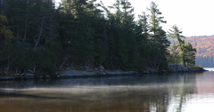 4K UltraHD A Mist rises from Algonquin the lake in fall Stock Footage