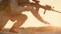 Side view Soldiers Lie Down on the Hill, Aim through the Assault Rifle Scope  Stock Footage