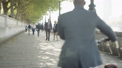 4K Cheerful London business group chatting as they walk through the city Stock Footage