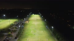 Aerial shot of soccer fields in the evening Stock Footage