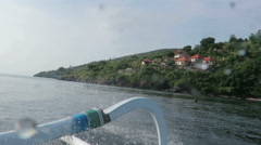 View from boat lagoon and green coast village. Bali, Indonesia Stock Footage