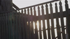 Sun through a picket fence Stock Footage