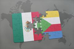 Puzzle with the national flag of mexico and comoros on a world map background Stock Photos