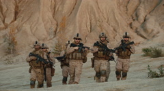 16 96 92 Group of soldiers walking in desert  Stock Footage