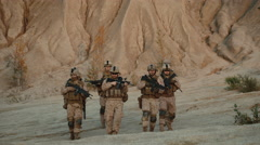 Squad of Fully Equipped and Armed Soldiers Walking Forward towards Camera  Stock Footage