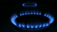 Two gas fire from kitchen in dark Stock Footage
