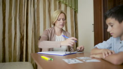 Female psychologist with the boy. Stock Footage