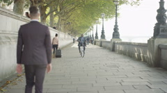 4K Cheerful London businessman cycling in the city. Stock Footage