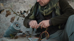 Terrorist Making a Bomb and Setting Timer. Stock Footage