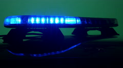 Police car lights, red, blue, from the side Stock Footage