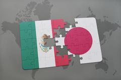 Puzzle with the national flag of mexico and japan on a world map background. Stock Photos