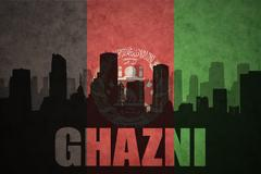 Abstract silhouette of the city with text Ghazni at the vintage afghanistan f Stock Photos