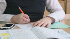 Student decides the task in the copybook Stock Footage