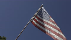 American flag posted outside of home along fence 4k Stock Footage