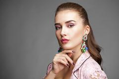 Beautiful young woman in pink lace jacket Stock Photos