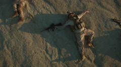 Flying over Group of Died Soldiers in Desert Area. Zooming Out. Stock Footage
