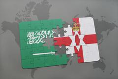 Puzzle with the national flag of saudi arabia and northern ireland on a world Stock Photos