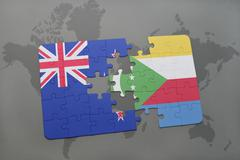 Puzzle with the national flag of new zealand and comoros on a world map backg Stock Photos