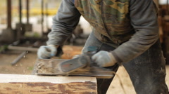 Construction worker planing a piece of wood for a building project. Construction Stock Footage
