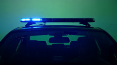 Police car lights, blue on green screen in dim light Stock Footage